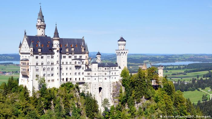 Side view of Neuschwanstein Castle and surrounding landscape, Bavaria, Germany