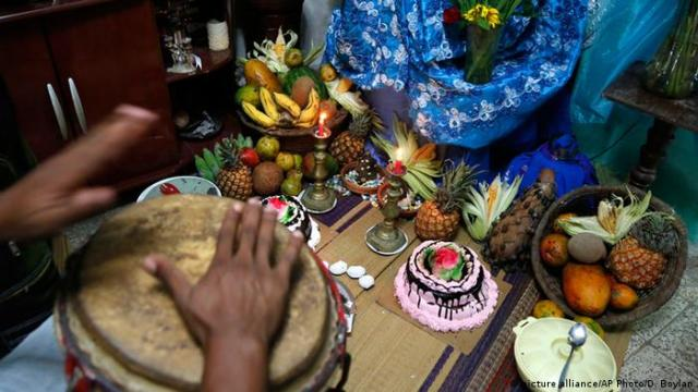Musician playing drums at a Santeria ceremony in Havana in 2015