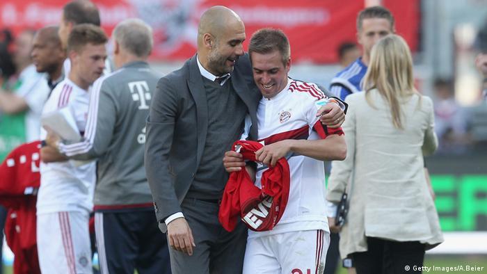Bayern Munich's Pep Guardiola and Philipp Lahm