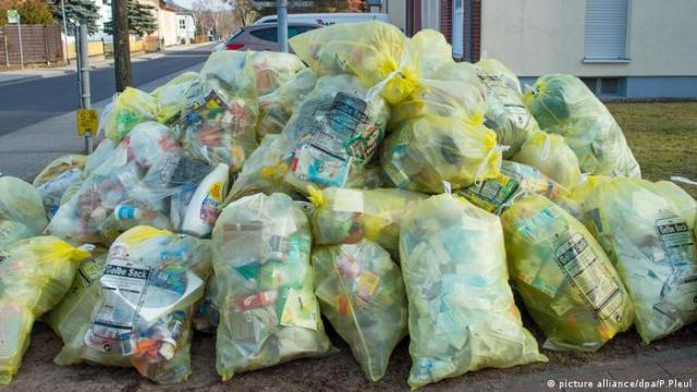 Plastic waste piled up in yellow bags.