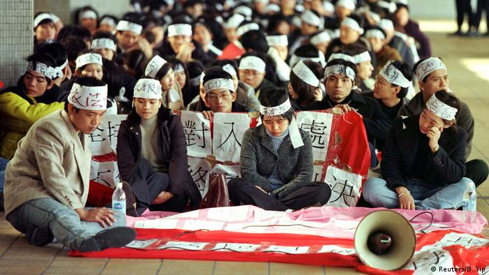 This 1999 photo shows Chinese visitors protesting after their residence permit was denied.