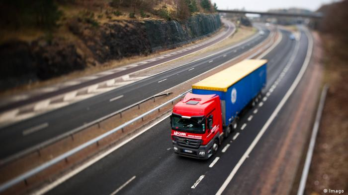 A photo of a a truck on a motorway