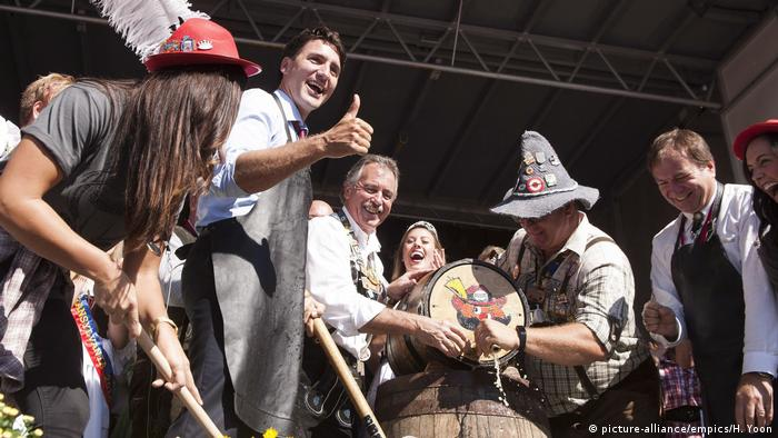 Justin Trudeau taps the keg at the Kitchner-Waterloo Oktoberfest in Canada.