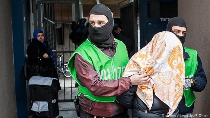 Islamist activist being arrested during a raid