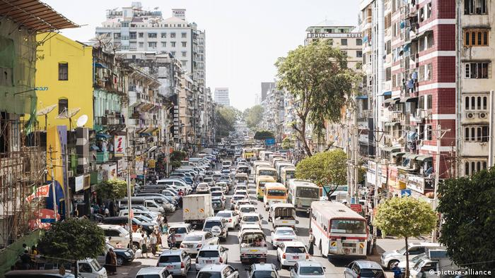 A road filled with traffic in Yangon, Myanmar