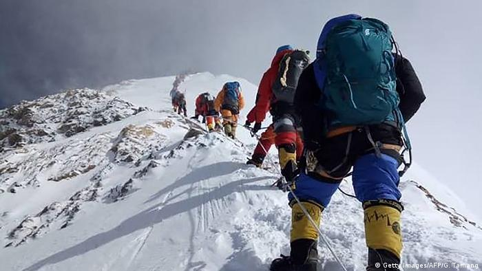 Mountaineers climb Everest, the highest mountain in the world.