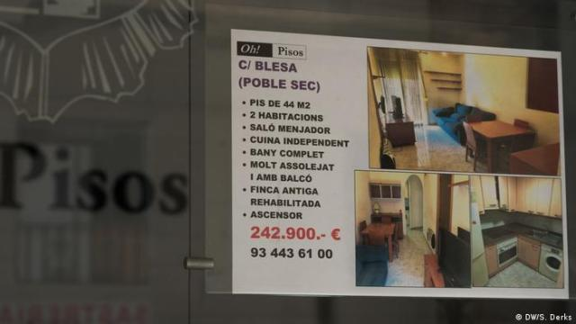 A sign advertising an apartment for sale