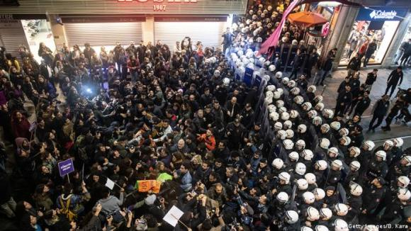 Demonstrators face off against police in Istanbul during a march condemning violence against women