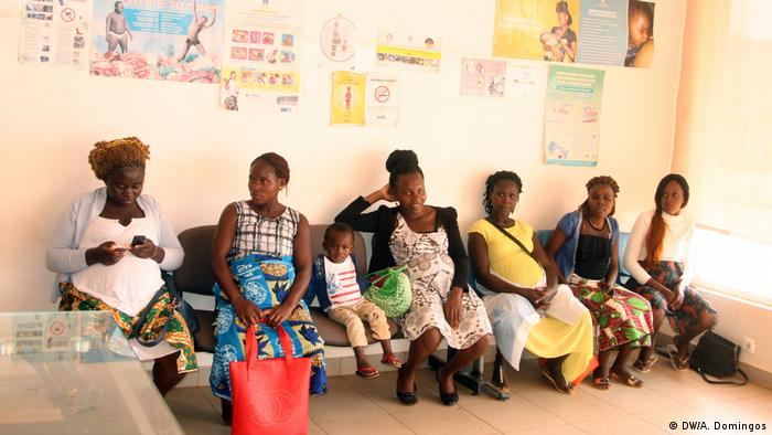Women sit in a waiting room inside a medical clinic in Angola
