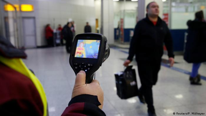 Kazakh sanitary-epidemiological service worker uses a thermal scanner to detect travellers from China who may have symptoms possibly connected with the previously unknown coronavirus, at Almaty International Airport, Kazakhstan January 21, 2020. REUTERS/Pavel Mikheyev
