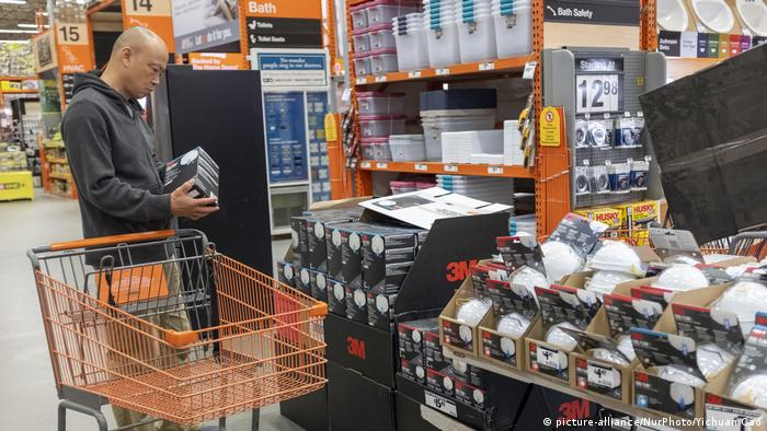 A customer shops for 3M N95 particulate filtering face mask at a store in East Palo Alto, California
