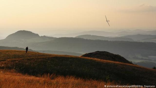 Model airplane over the Wasserkuppe mountain, Germany (picture-alliance/imageBROKER/m. Siepmann)