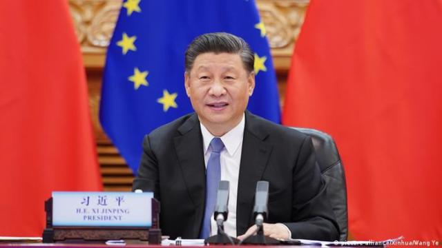 Xi Jinping speaks before an EU flag