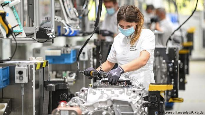 Female worker in automobile plant