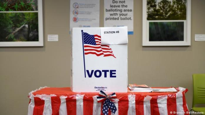 A voting both in Georgia (Brandon Bell/Reuters)