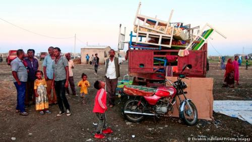 Ethiopian refugees gather their belongings in a Sudanese border town (Ebrahim Hamid/AFP/Getty Images)