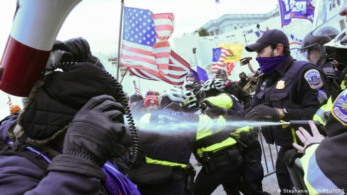 Supporters of US President Donald Trump clash with police officers in front of the US Capitol Building in Washington