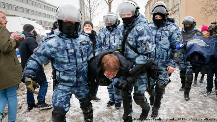 Russian police carry a protester in Moscow