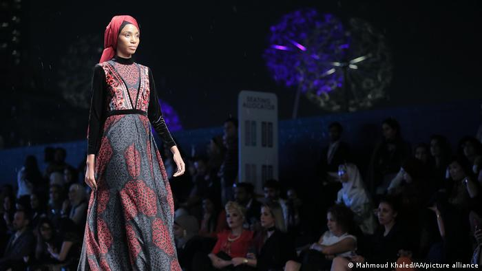A model presents a creation by Muslima Wear at the Dubai Modest Fashion Show 2017. Modest fashion can also be understood in different ways: Bright colors and large patterns are more likely to be found in Dubai than in Riyadh.