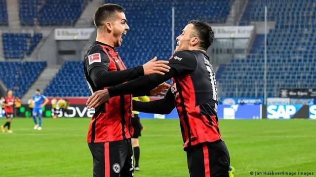 Andre Silva and Filip Kostic celebrate a goal for Eintracht Frankfurt.