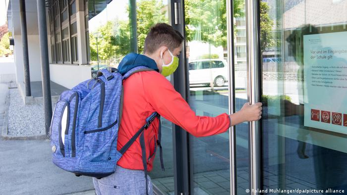 Austria easing schools and shops open under strict conditions