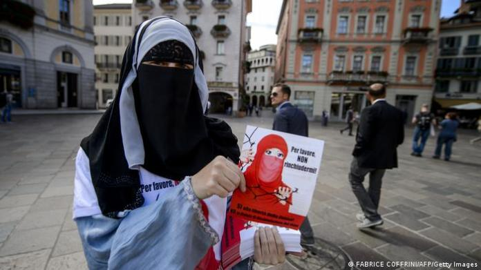 Islamic Central Council of Switzerland member Nora Illi, one of the few Swiss women wearing the niqab, poses on September 18, 2013 while distributing flyers reading Please don't lock me up