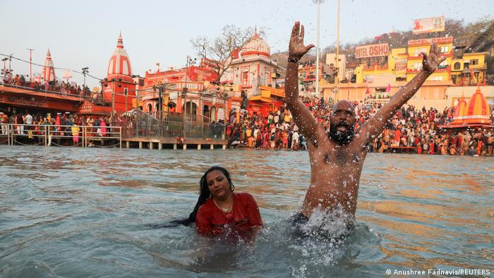 Devotees bathe in the Ganges River during the first auspicious bathing day at the Kumbh Mela festival in Haridwar