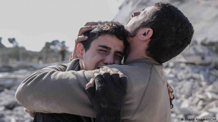 A photos from the Syrian photographer Ghaith Alsayed shows two brothers mourning