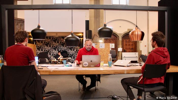 Three men sitting at a co-working space in the Digital Church