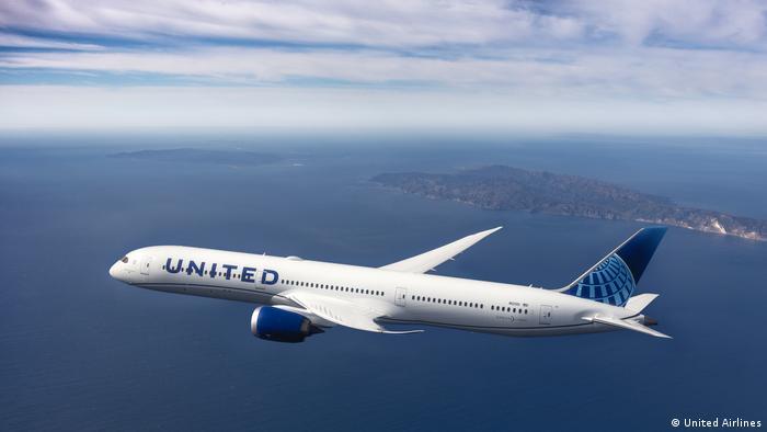 Plane flies over the ocean