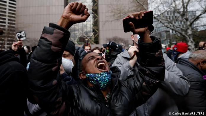 A Black man celebrates after the guilty verdict is read out in Derek Chauvin's trial