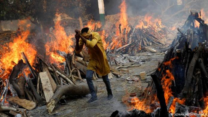pyres in India and man