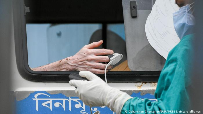 Hand of a patient having blood oxygen measured.