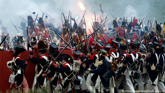 Reenactment scene of the Battle of Waterloo, showing many soldiers fighting against one another.