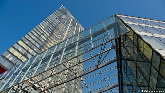 Cosmopolitan Twarda 2/4 building in Warsaw, Poland with glass and metal construction.