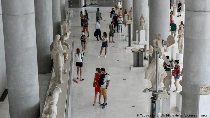 Visitors wearing masks at the Parthenon Museum in Athens.