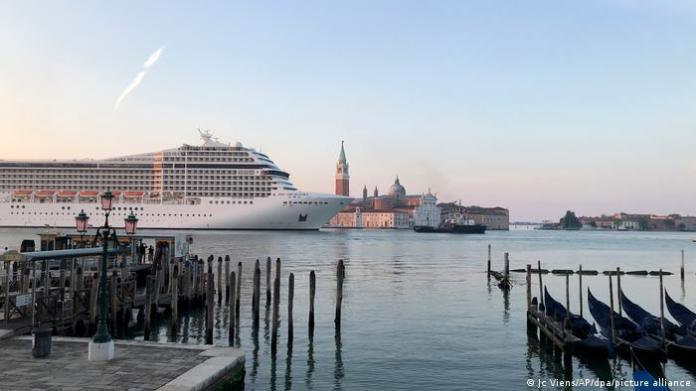 The cruise ship MSC Orchestra makes its way down the Giudecca Canal in Venice, Italy