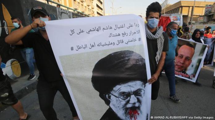 Iraqi demonstrators attend a symbolic funeral for slain Iraqi jihadism expert Hisham al-Hashemi.