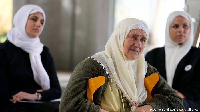 Women from Srebrenica wait to hear the verdict in The Hague