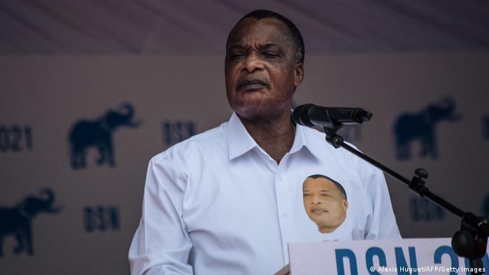 Denis Sassou Nguesso delivers a speech in front of a microphone