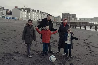 Mohammad Karkoubi, his wife Eshraq their children Mustafa, Mayas and Rimas. They moved to Wales in December 2015.