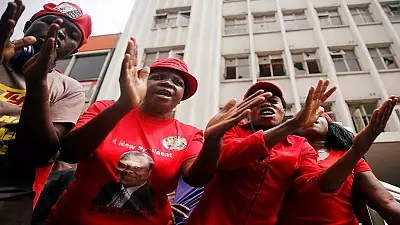 Morgan Tsvangirai's body arrives in Zimbabwe to a rapturous welcome