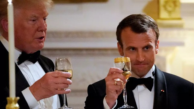 Trump hosts Macron at gala dinner and hints at new Iran deal