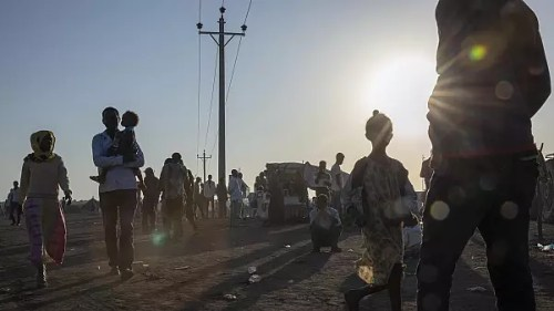 Tigray refugees who fled the conflict in the Ethiopia's Tigray walk at Hamdeyat Transition Center near the Sudan-Ethiopia border, eastern Sudan, Thursday, Dec. 3, 2020.