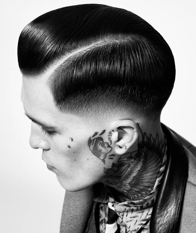 Slick back comb over fade hairstyle for men