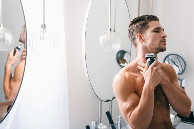 Man With Electric Shaver