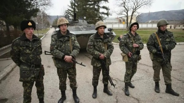 Ukraine starts army drills as Russian military guards ...