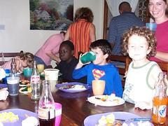 Kids eating turkey