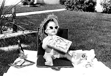 Baby sunbathing on lawn in California 2 Apr 1960 - Bettmann