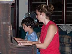 Malachi learning to play piano